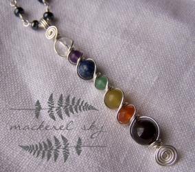 Chakra necklace in sterling silver, with garnet, carnelian, yellow jade, aventurine, lapis lazuli, amethyst, and quartz. 2013