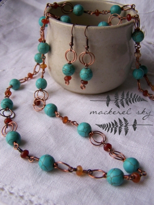 Earring and long necklace set in recycled copper, turquoise, and carnelian.
