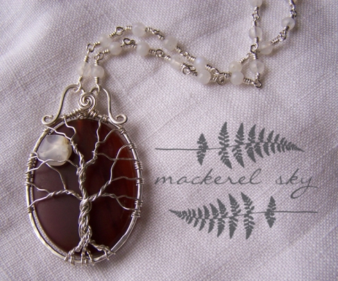 Full moon at sunset tree in sterling silver, with carnelian and moonstone.