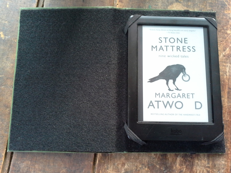 My e-reader in the finished cover.